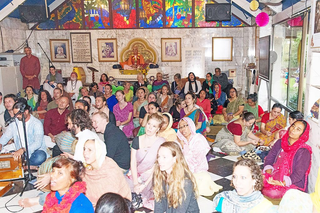 Devotees gather together for kirtana