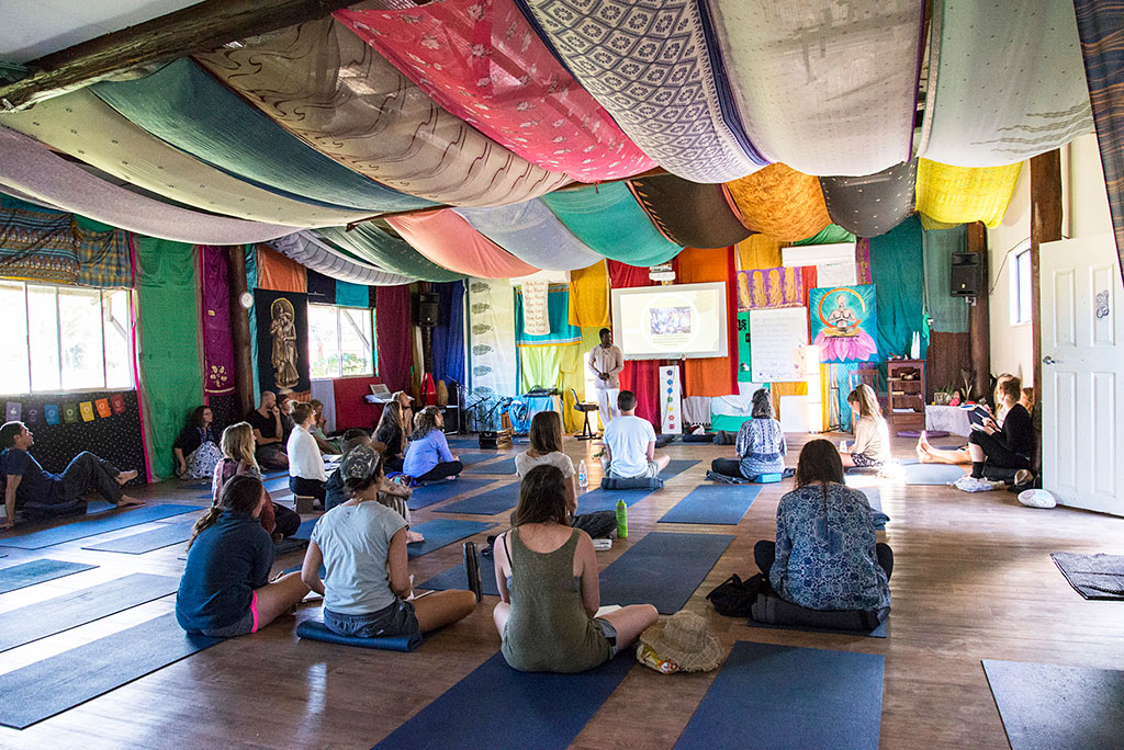 Students gather in the Yoga Hall to hear Michael Olabode lecture on the Yoga Sutras.