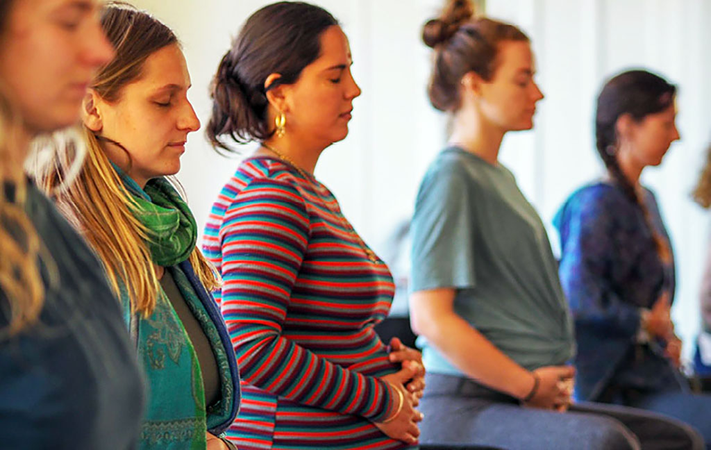 Mothers-to-be absorbed at the Yoga of Birth course held at Krishna Village.