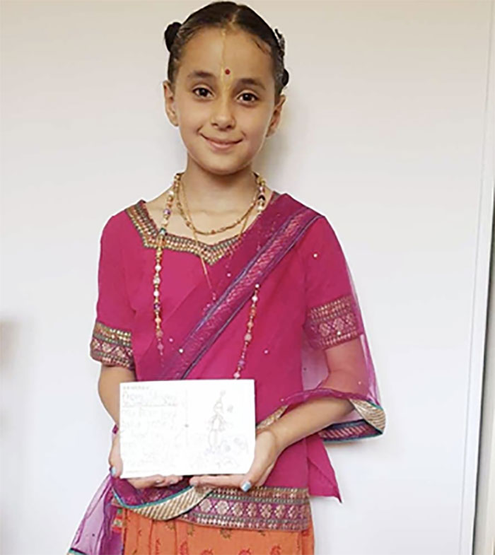 Shivani made a card with a beautiful picture of Krishna surrounded by lotuses.