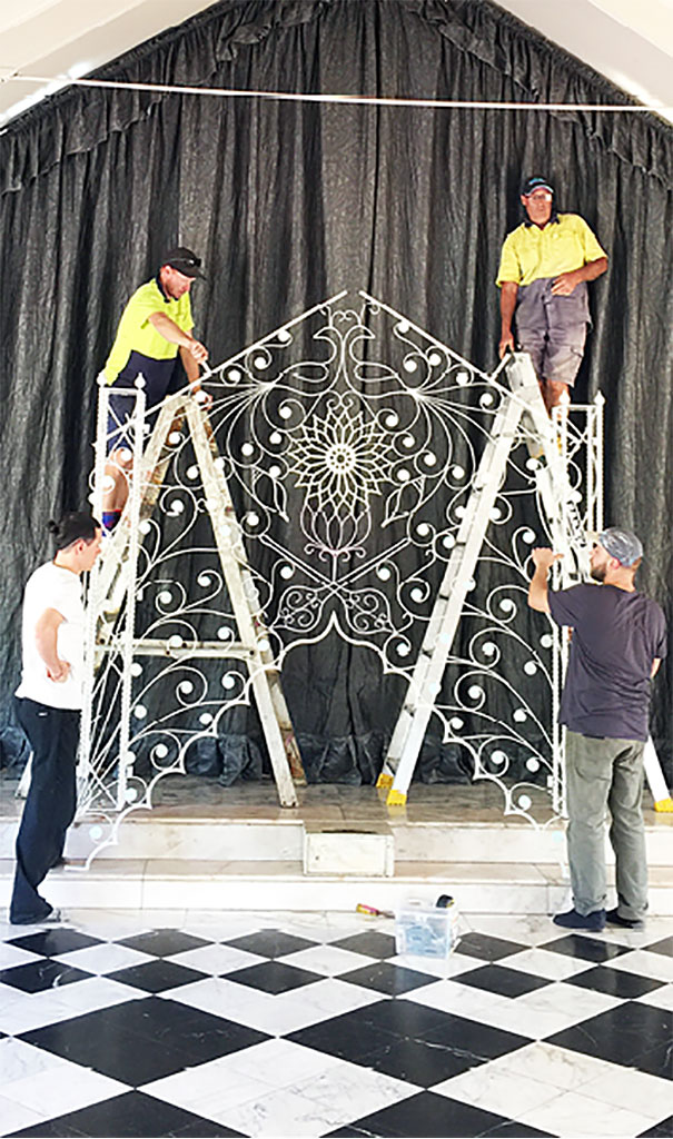 All hands on deck as the refurbished gates are erected back into position.