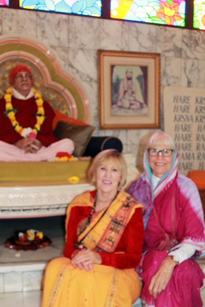 Her Grace Krishnarupa devi dasi (L) and Her Grace Ambika devi dasi with New Govardhana's murti form of their beloved spiritual master, ISKCON's Founder-Acharya His Divine Grace A.C. Bhaktivedanta Swami Prabhupada.