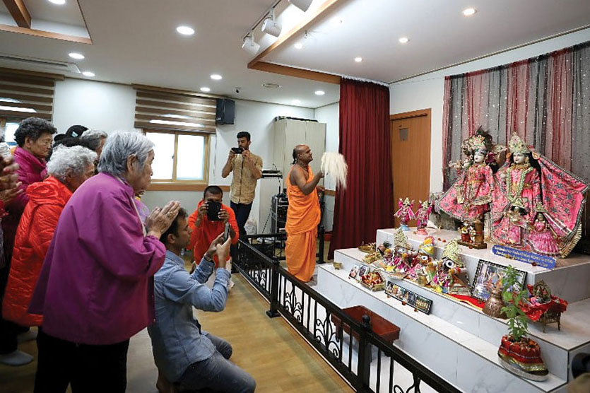 The locals are showing their respects to the Deities at the Korean ISKCON temple opening ceremony.